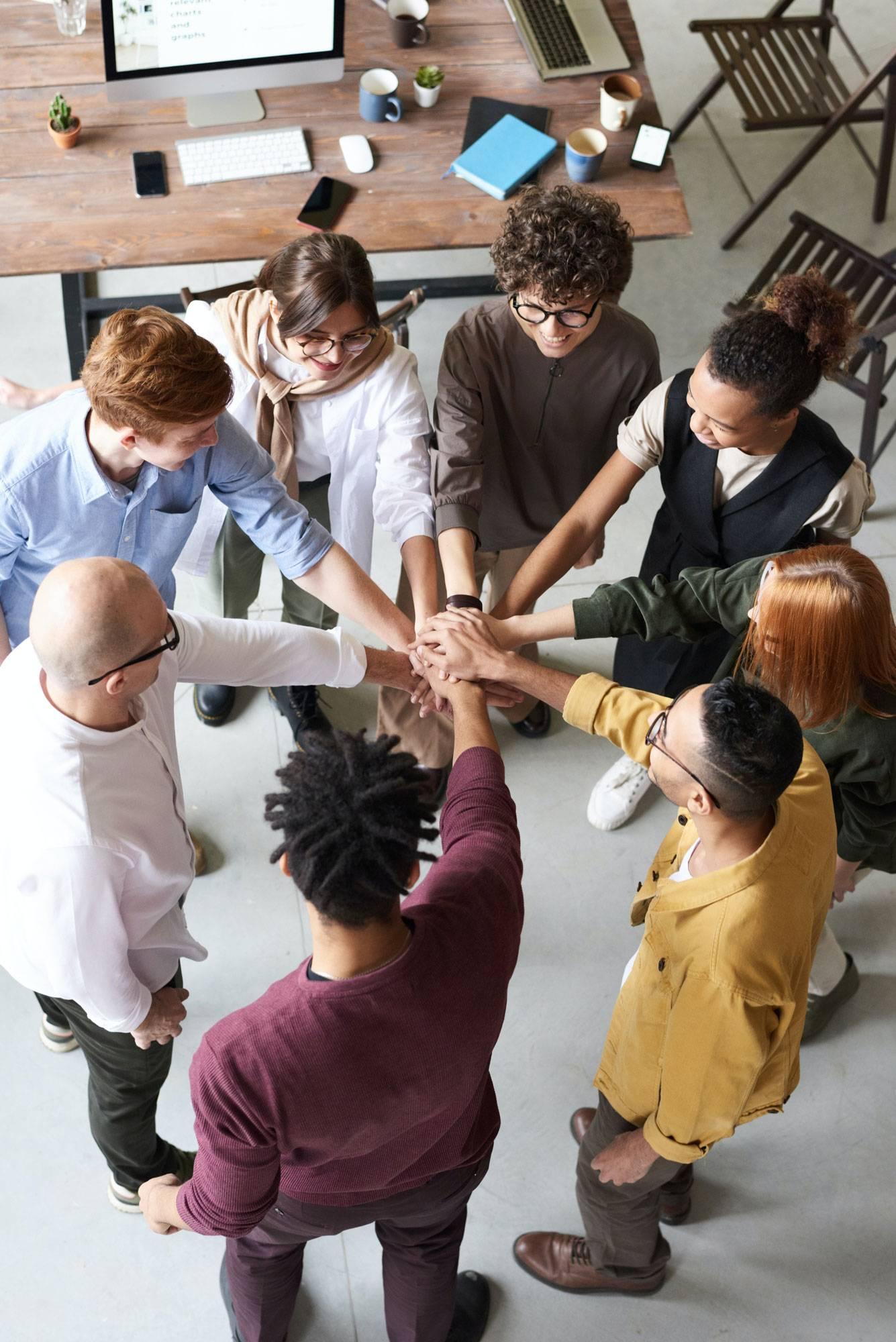 Entrepreneurs huddling in unity