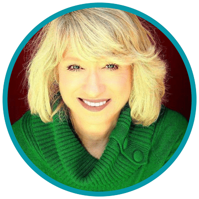 Mary Maas headshot - a white woman with blonde hair wearing a green sweater